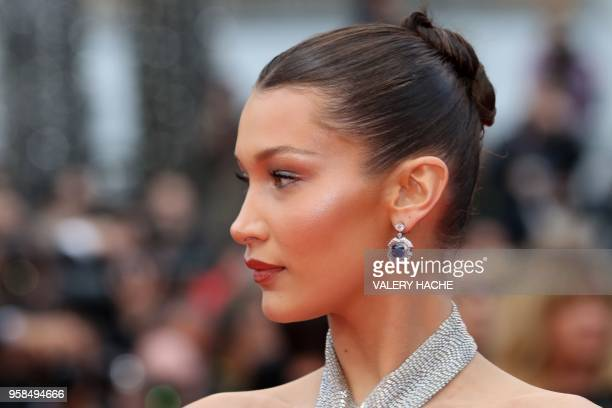 US model Bella Hadid poses as she arrives on May 14 2018 for the screening of the film BlacKkKlansman at the 71st edition of the Cannes Film Festival...