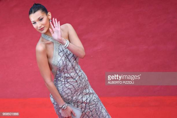 US model Bella Hadid poses as she arrives on May 14 2018 for the screening of the film 'BlacKkKlansman' at the 71st edition of the Cannes Film...