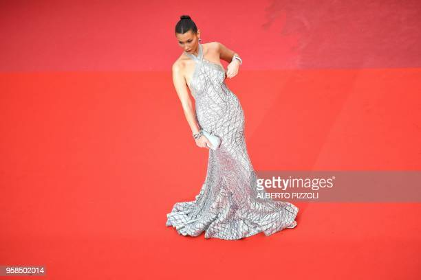 TOPSHOT US model Bella Hadid poses as she arrives on May 14 2018 for the screening of the film 'BlacKkKlansman' at the 71st edition of the Cannes...
