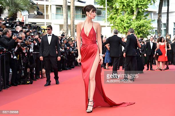US model Bella Hadid poses as she arrives on May 18 2016 for the screening of the film 'The Unknown Girl ' at the 69th Cannes Film Festival in Cannes...