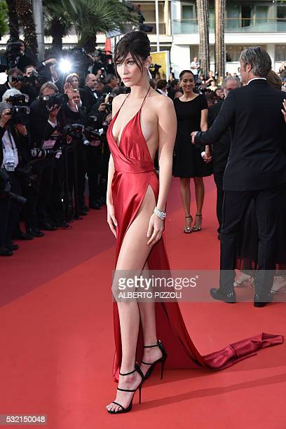US model Bella Hadid poses as she arrives on May 18 2016 for the screening of the film The Unknown Girl at the 69th Cannes Film Festival in Cannes...