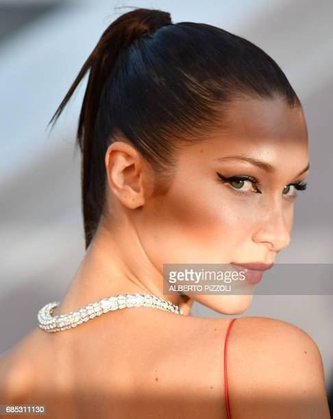 TOPSHOT US model Bella Hadid poses as she arrives on May 19 2017 for the screening of the film 'Okja' at the 70th edition of the Cannes Film Festival...
