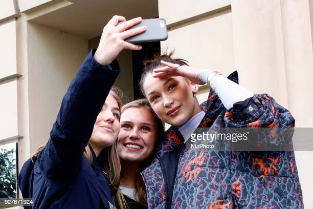 US model Bella Hadid poses for selfies in Paris France on March 5 2018