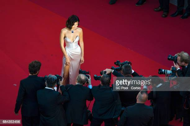 Model Bella Hadid poses for the photographers before the Ismael's Ghosts screening and Opening Gala during the 70th annual Cannes Film Festival at...
