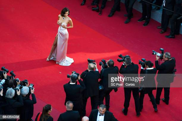 Model Bella Hadid poses for the photographers before the 'Ismael's Ghosts ' screening and Opening Gala during the 70th annual Cannes Film Festival at...