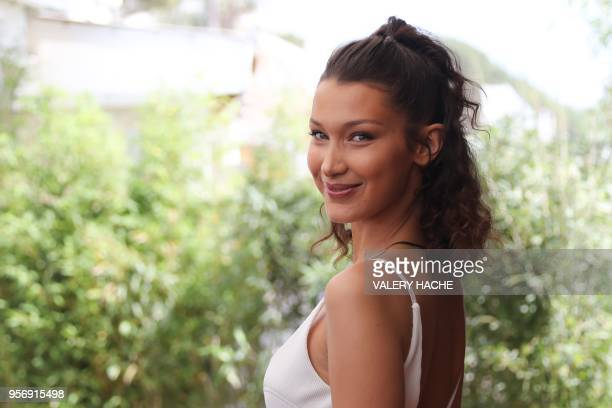 Model Bella Hadid poses on May 10, 2018 during a promotional event on a private beach at the 71st edition of the Cannes Film Festival in Cannes,...