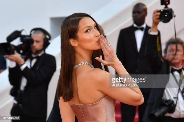 US model Bella Hadid poses she arrives on May 11 2018 for the screening of the film 'Ash is Purest White ' at the 71st edition of the Cannes Film...