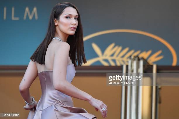TOPSHOT US model Bella Hadid poses she arrives on May 11 2018 for the screening of the film 'Ash is Purest White ' at the 71st edition of the Cannes...