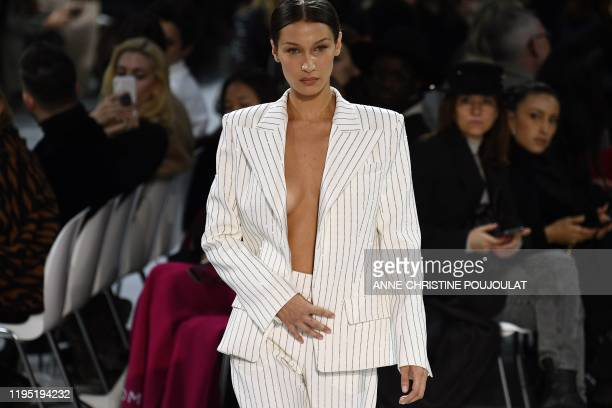 Model Bella Hadid presents a creation by Alexandre Vauthier during the Women's Spring-Summer 2020/2021 Haute Couture collection fashion show in...