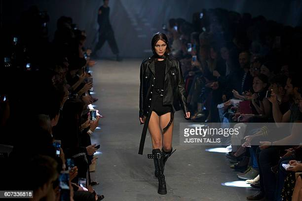 US model Bella Hadid presents a creation by Italian designer Versace's Versus label during the 2017 Spring / Summer catwalk show at London Fashion...