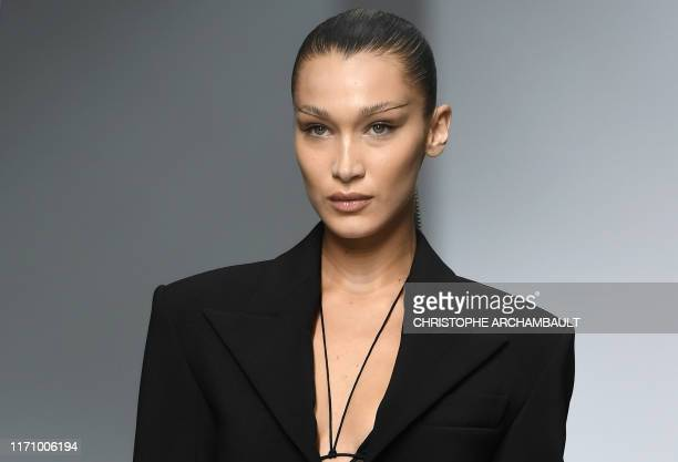 Model Bella Hadid presents a creation by Mugler during the Women's Spring-Summer 2020 Ready-to-Wear collection fashion show in Paris, on September...