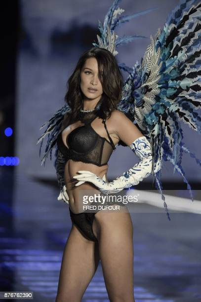 US model Bella Hadid presents a creation during the 2017 Victoria's Secret Fashion Show in Shanghai on November 20 2017 / AFP PHOTO / FRED DUFOUR /...