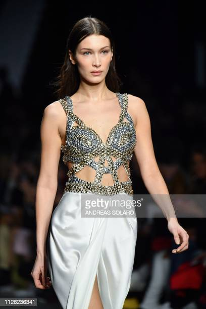 Model Bella Hadid presents a creation during the Alberta Ferretti women's Fall/Winter 2019/2020 collection fashion show on February 20 2019 in Milan
