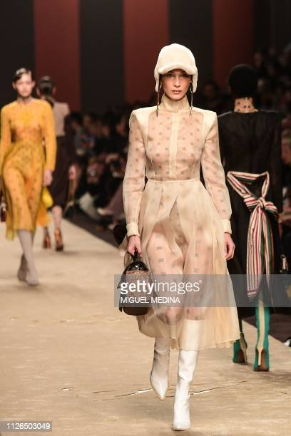 Model Bella Hadid presents a creation during the Fendi women's Fall/Winter 2019/2020 collection fashion show on February 21 2019 in Milan