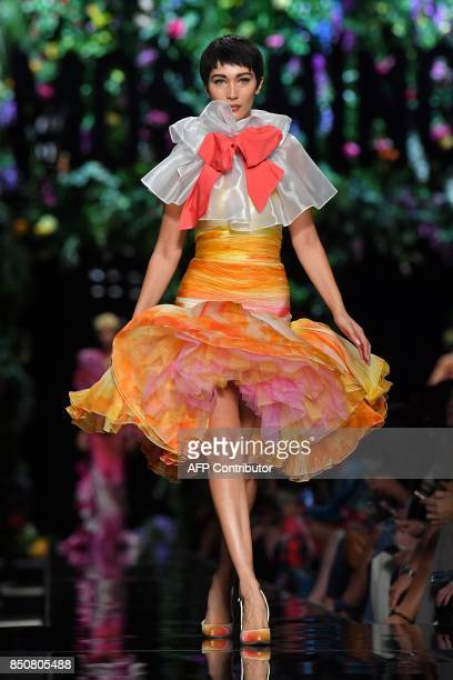 Model Bella Hadid presents a creation for fashion house Moschino during the Women's Spring/Summer 2018 fashion shows in Milan on September 21 2017 /...