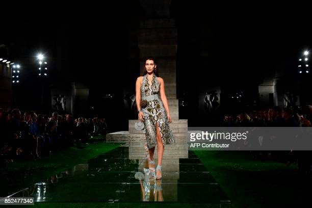 Model Bella Hadid presents a creation for fashion house Salvatore Ferragamo during the Women's Spring/Summer 2018 fashion shows in Milan, on...