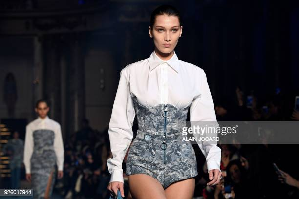 TOPSHOT US model Bella Hadid presents a creation for OffWhite during the 2018/2019 fall/winter collection fashion show on March 1 2018 in Paris / AFP...