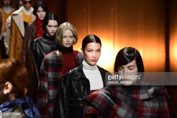 Model Bella Hadid presents a creation for Tod's Women Fall - Winter 2020 fashion collection on February 21, 2020 in Milan.