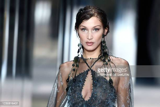 Model Bella Hadid presents a creation of British designer Kim Jones for the Fendi's Spring-Summer 2021 collection during the Paris Haute Couture...