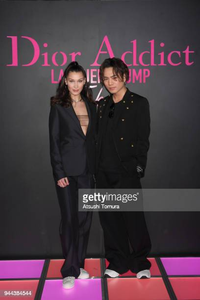 Model Bella Hadid Singer/Actor Hiroomi Tosaka attend the Dior Addict Lacquer Plump Party at 1 OAK on April 10 2018 in Tokyo Japan