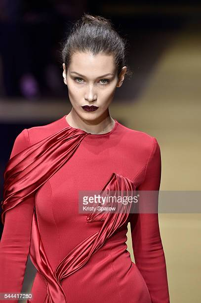 Model Bella Hadid walks the runway during the Atelier Versace Haute Couture Fall/Winter 20162017 show as part of Paris Fashion Week on July 3 2016 in...