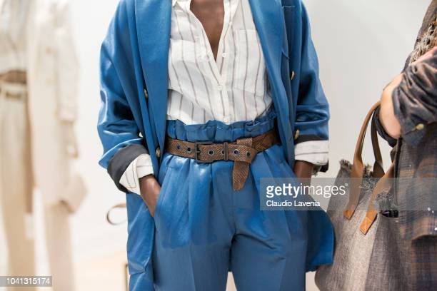 A model belt detail is seen at the Brunello Cucinelli presentation during Milan Fashion Week Spring/Summer 2019 on September 19 2018 in Milan Italy