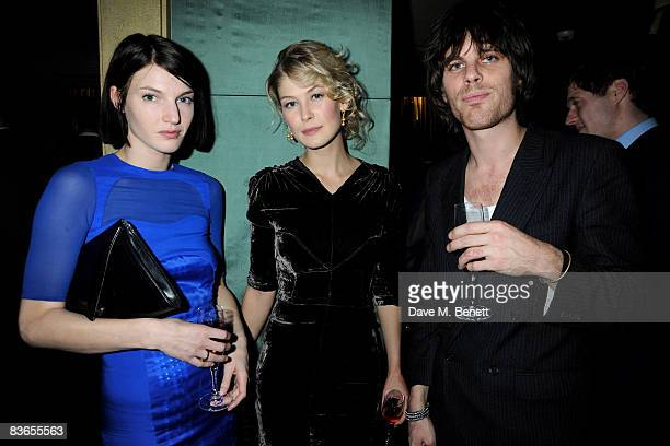 Model Ben Grimes actress Rosamund Pike and musician Jackson Scott attend the 10th anniversary party of Claridge's Bar November 11 2008 in London...