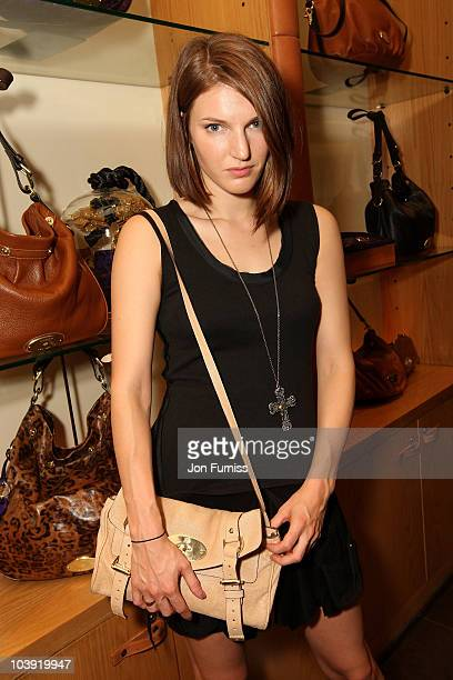 Model Ben Grimes, holding the Mulberry Alexa clutch bag, attends Mulberry's Vogue Fashion Night Out celebration at the flagship Bond Street store on...
