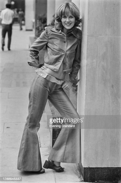 Model Bertie wearing a denim jacket and flared trousers at a preview of the Miss Levi spring collection at the Sonesta Tower Hotel, London, UK, 14th...