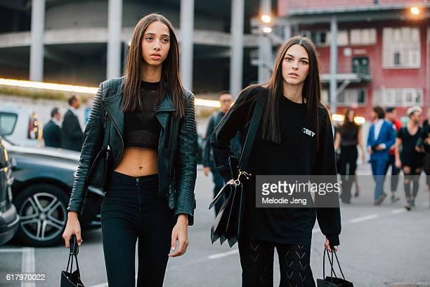 Model best friends Yasmin Wijnaldum Vittoria Ceretti wear all black outfits after the Versace show during Milan Fashion Week Spring/Summer 2017 on...