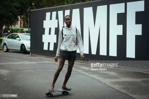 Model Beto Chuol leaves the Royal Exhibition Building on a skateboard on March 13 2020 in Melbourne Australia Melbourne Fashion Festival organisers...