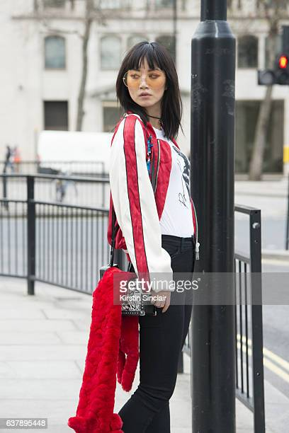 Model Betty Bachz wears a Pam Hogg T shirt MCM bag Moy Atelier by betty Bachz sunglasses and Unravel jacket and trousers day 1 of London Mens Fashion...
