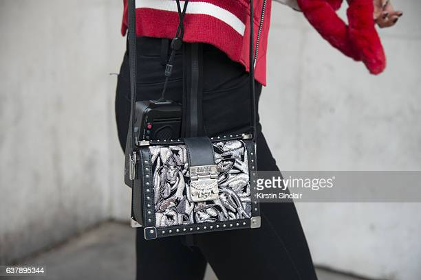 Model Betty Bachz wears an MCM bag and Unravel jacket and trousers day 1 of London Mens Fashion Week Autumn/Winterr 2017 on January 06 2017 in London...