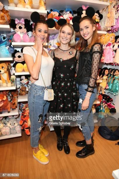 Model Betty TaubeGuenter Kim Hnizdo and Anne Wilken during the Disney Store VIP opening on November 8 2017 in Munich Germany