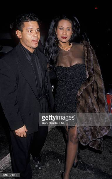 Model Beverly Johnson and date attending 'Rock N Roll Hall of Fame Party' on January 17 1990 at Sting's home in New York City New York