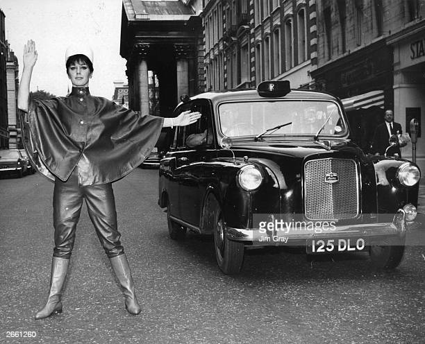 Model Beverly Scott stopping the traffic in a Nina Ricci leather gendarme suit