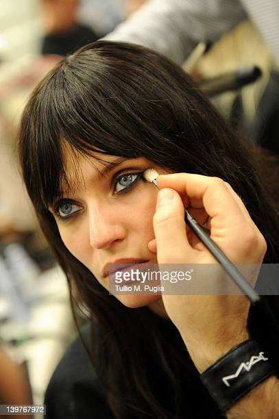 Model Bianca Balti prepares backstage at the Iceberg Autumn/Winter 2012/2013 fashion show as part of Milan Womenswear Fashion Week on February 24...