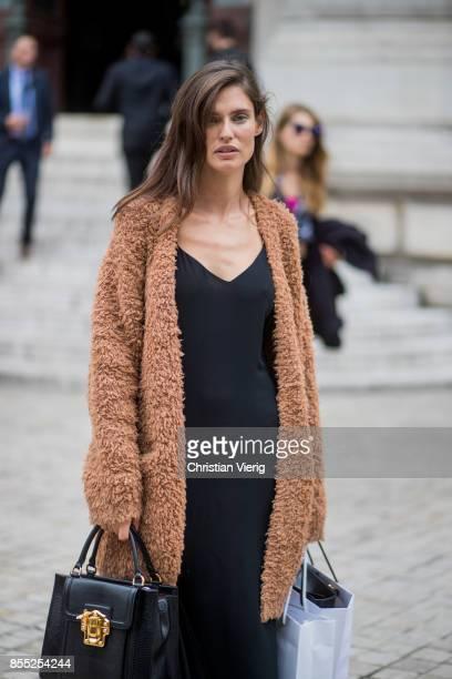 Model Bianca Balti wearing coat, black dress is seen outside Balmain during Paris Fashion Week Spring/Summer 2018 on September 28, 2017 in Paris,...