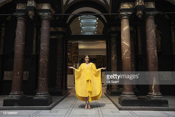 Model Bianca Gavrilas wears a a handembroidered cape made from the silk of the Golden Orb Spider in the VA Museum's Medieval and Renaissance Gallery...