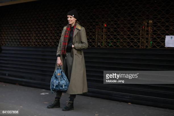 Model Bianca O'Brien wears a green Alexander McQueen jacket Barbour vest denim backpack and black boots outside the Y/PROJECT show on January 18 2017...