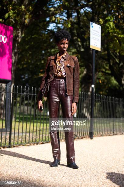 Model Bibi Abdulkadir in a brown leather and suede outfit during London Fashion Week September 2018 on September 13 2018 in London England