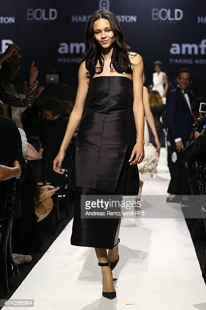Model Binx Walton walks during the fashion show runway during amfAR's 22nd Cinema Against AIDS Gala Presented By Bold Films And Harry Winston at...