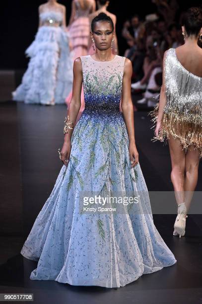 Model Binx Walton walks the runway during the George Hobeika Haute Couture Fall Winter 2018/2019 show as part of Paris Fashion Week on July 2 2018 in...