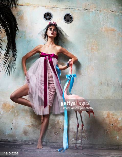 Model Blanca Padilla is photographed for Madame Figaro on January 26, 2018 in Paris, France. Dress and veil by Chanel Haute Couture, ribbon from...