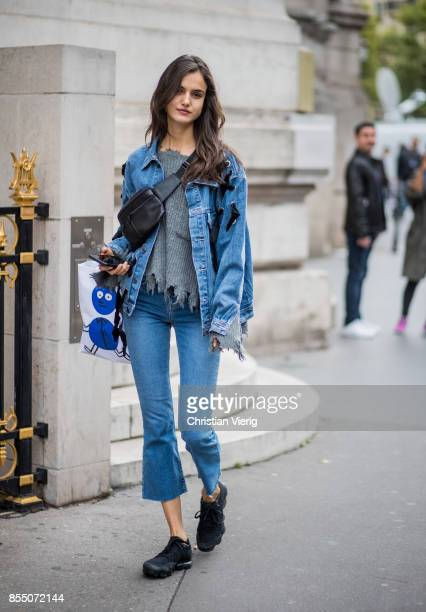 Model Blanca Padilla wearing denim jacket cropped denim jeans seen outside Balmain during Paris Fashion Week Spring/Summer 2018 on September 28 2017...