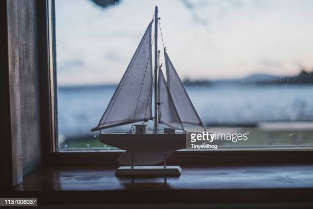 model boat on a window ledge - sailing stock pictures, royalty-free photos & images