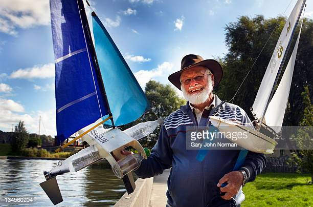 model boat owner displays his craft - nautical vessel stock pictures, royalty-free photos & images