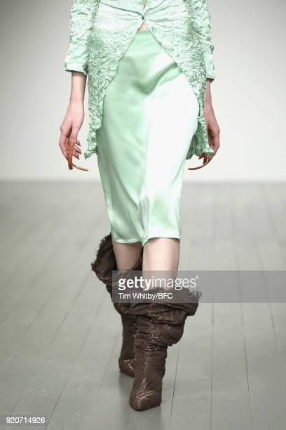 A model boot detail walks the runway at the Faustine Steinmetz show during London Fashion Week February 2018 at BFC Show Space on February 19 2018 in...