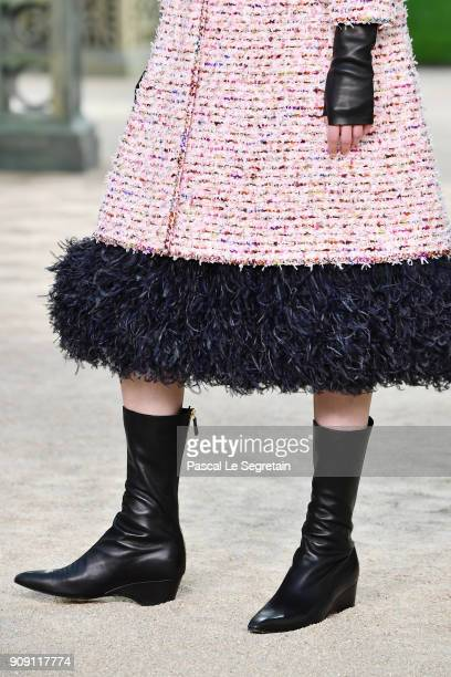 A model boot detail walks the runway during the Chanel Spring Summer 2018 show as part of Paris Fashion Week on January 23 2018 in Paris France