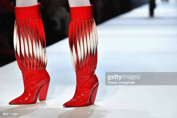 A model boot detail walks the runway during the JeanPaul Gaultier Spring Summer 2018 show as part of Paris Fashion Week on January 24 2018 in Paris...
